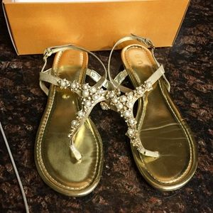 Golden jeweled sandals