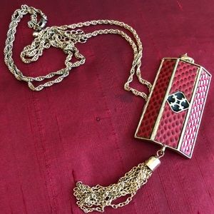 Long chain necklace with red rectangular plaque