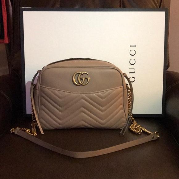 6bf604bc82c8 Gucci Handbags - GG Marmont medium maltelessé shoulder bag in Beige