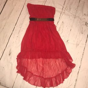 Red strapless high low dress with black belt