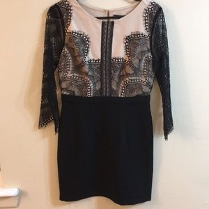 Lacy dress with sleeves