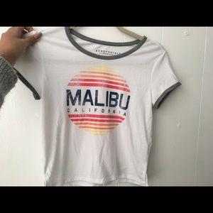 A white crop top that says Malibu California