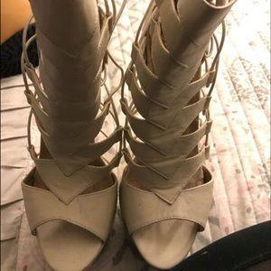 Nude high heels.
