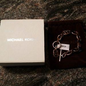 Authentic Michael Kors gold tortoise bracelet