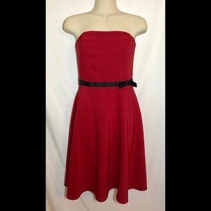 Red sleeveless cocktail dress w/ black ribbon