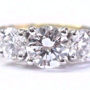 Tiffany & Co 18Kt Three-Stone Round Cut Diamond En