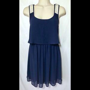 Navy blue sleeveless dress with sheer overlay