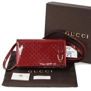 GUCCI embossed GG Patent leather bag