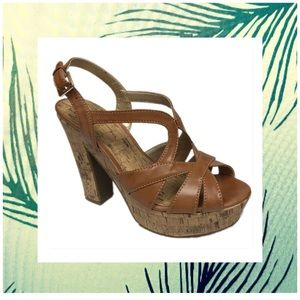 G by guess brown slip on platform heels.