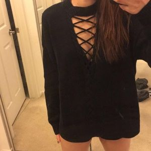 Black Kendall and Kylie sweater. Detailed V neck