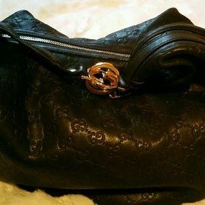 Authentic black Leather Gucci bag.