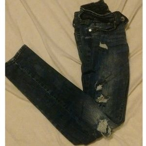 Distressed dark wash skinny jeans