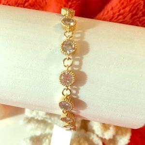Feminine Gold plated and round 9 CZ bracelet