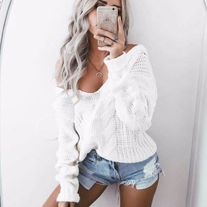white cable knit v neck sweater
