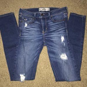 Hollister distressed skinny jeans.