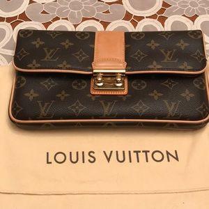 Louis Vuitton - Slim Monogram Sofia Coppola clutch