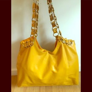 Yellow leather bag with metal straps