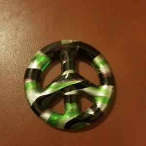 Glass peace sign