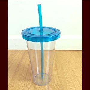 Clear acrylic tumbler with blue straw