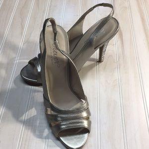 Beautiful pair of silver  heels new