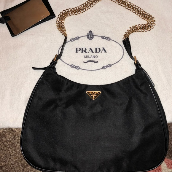 666e9740ce8 Authentic Prada mini bag with gold chain. M_5a19ef11a88e7d008b02d7ea