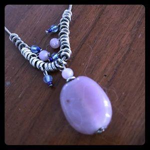 purple stone pendant on silver tone necklace