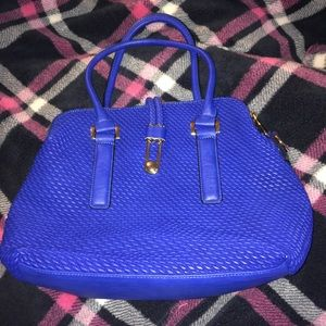 Royal Blue bag with gold accents.