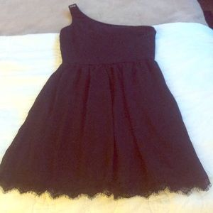 One shoulder black dress with gold button strap