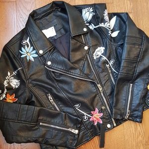 Black biker jacket. Secret keeper jacket.