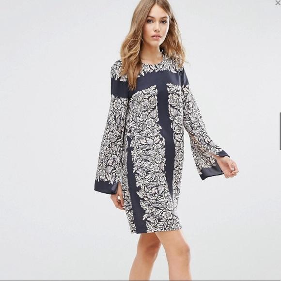 7cfc5b1ead2a4 Bcbg Bell Sleeve Tunic Dress Garden Scarf Print. BCBGMaxAzria.  M_5a1da65456b2d6bef311a69f. M_5a1da651713fdec0f311dfae.  M_5a1da652a88e7dabdc11f1a5