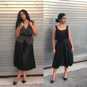 Dresses & Skirts - Beautiful faux leather pleated skirt!