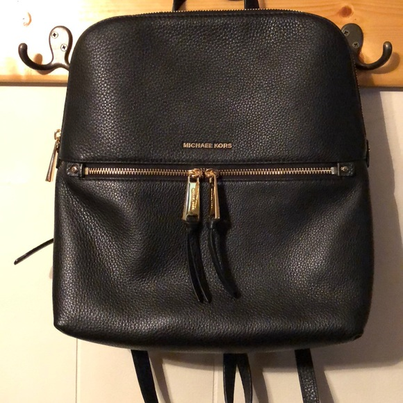 4832f1c3d394 Michael Kors Rhea Medium Slim Backpack. M_5a1dd336c2845688c6129210