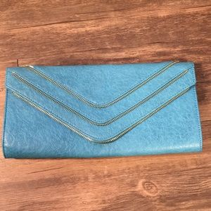 Turquoise clutch with Gold Zipper Detailing