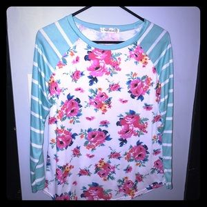 Raglan tee with striped sleeves and floral body