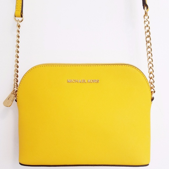 e66bf38435ea Michael Kors Sunflower Dome Crossbody. M_5a1dfaae4e95a36ce7135c72. Other  Bags you may like