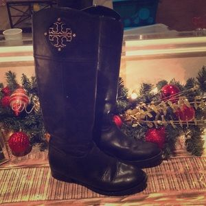 Tory Burch boots with gold emblem