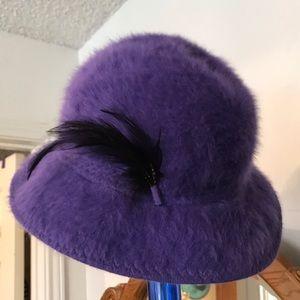 Precious purple fuzzy hat.