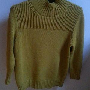 Beautiful hip length sweater NWOT. Never worn.