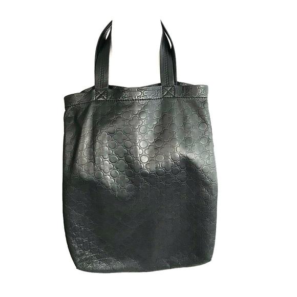 b720af11a Comme des Garcons Handbags - Comme des Garcons leather, clover embossed tote