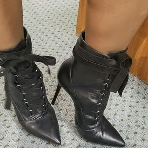Schutz Luamar pointy toe lace up booties.