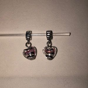2 pugster dangly charms