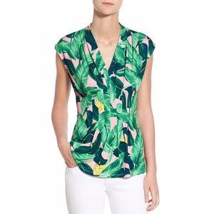 Tropical palm print sleeveless peplum blouse