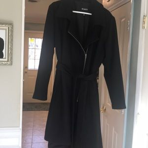 Black off-center zipped and belted coat