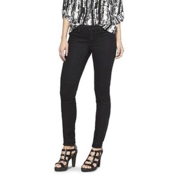 027190355f837 Mid Rise Power Stretch Black Denim Skinny Jeans. M_5a21bc1f7f0a05d06f007b9f