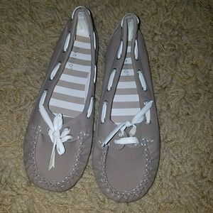 Beige and white boat shoes