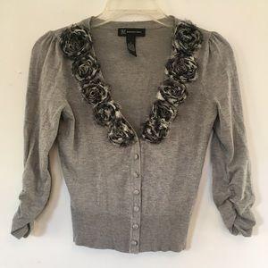 Ladies gray and black sweater.
