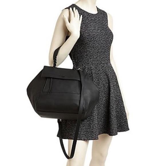 cb729390c0ef NWOT Tory burch half moon black satchel. M 5a221f4c8f0fc48ed101697e