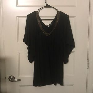 Black top with gold sequin accent