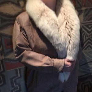 A raglan sleeve genuine leather coat trimmed w/fur