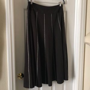 Brown flared winter skirt with white stitching